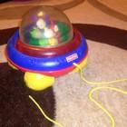 Веселая музыкальная каталка с шариком неваляшкой fischer price