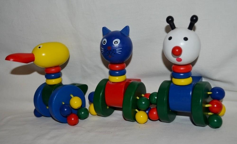 Деревянная игрушка каталка каталочка для малышей животные разные фото №1