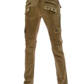 Зауженные дизайнерские брюки декорированные змейками