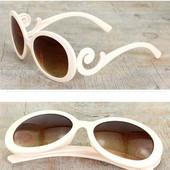 Очки с завитками в стиле Prada