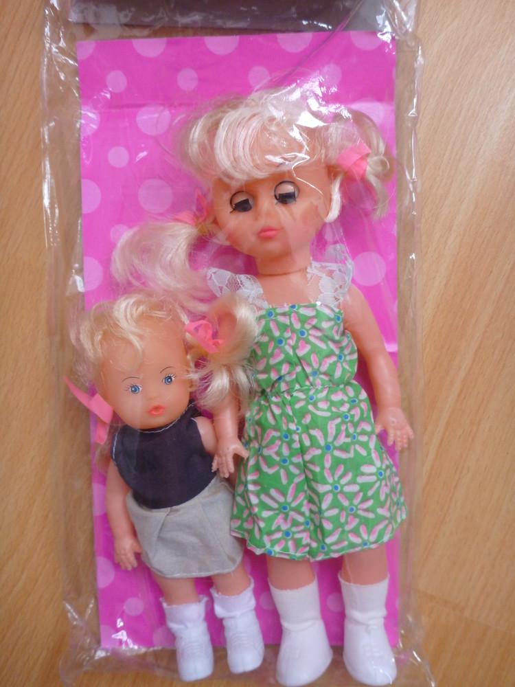 Яскраві ляльки в подарункових коробках фото №1