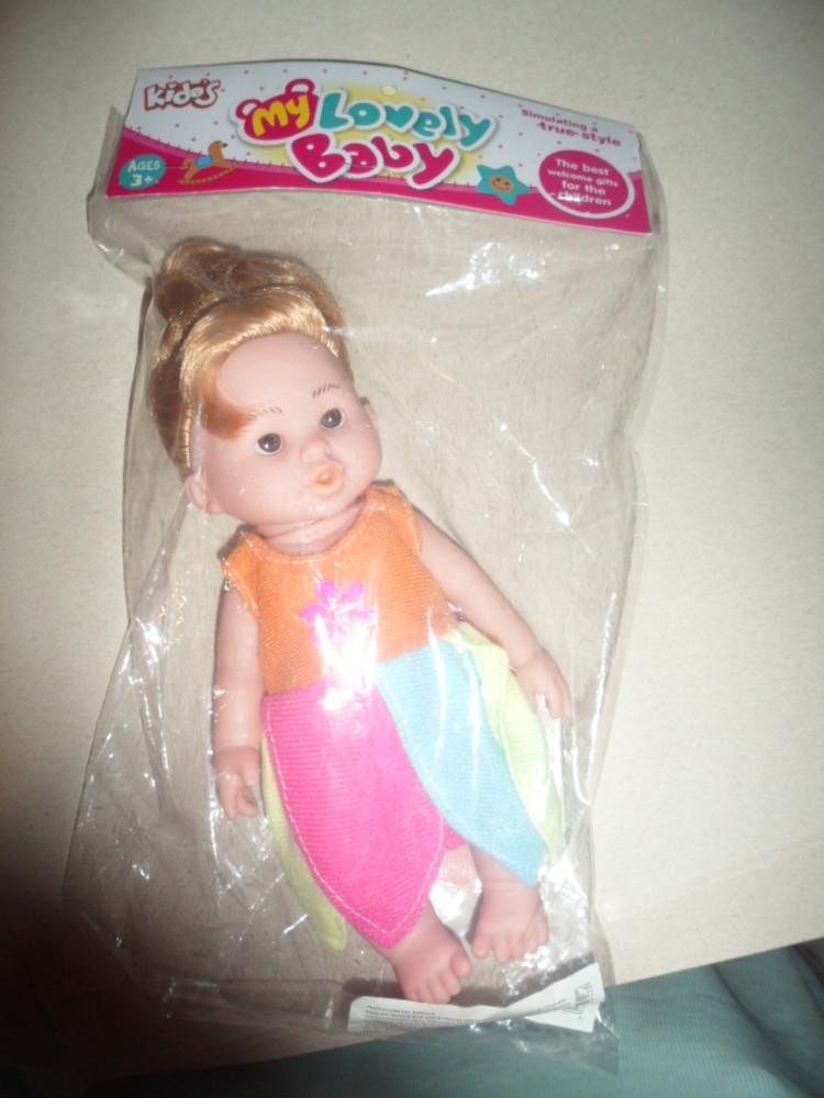 кукла резиновая музыкальная   фото №1