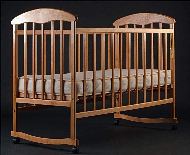Детская кроватка Наталка светлое дерево с колесиками и качалкой фото №1