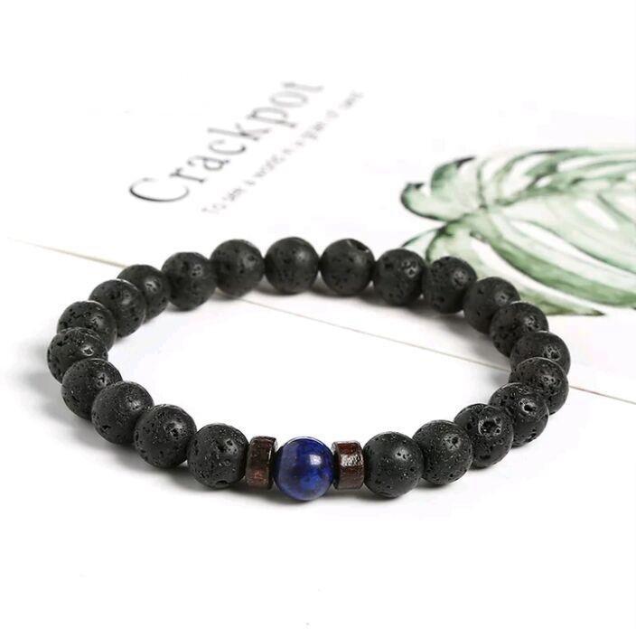 Стильный браслет из вулканической лавы черного цвета с натуральным камнем (сапфир) фото №1